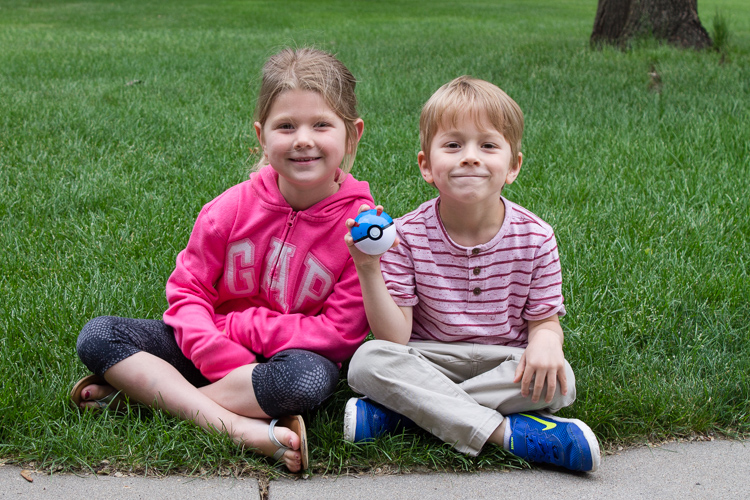 Cousins with Pokemon ball