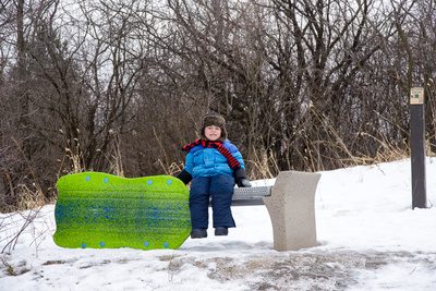 While his siblings were off having fun sliding down the hill, Damian froze to this bench