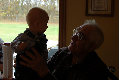 This moment between great-grandfather and great-grandson brought to you by a happy camera accident