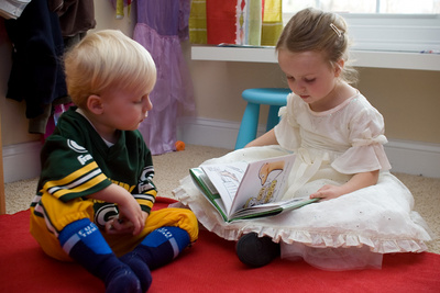 Celebrating Thanksgiving the traditional way, dressed as a football player and princess and reading stories to each other